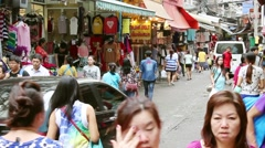 Stock Video Footage of People walk among of stalls in a narrow street