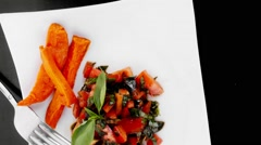 Vegetable salad : cherry tomatoes and basil with sweet baked potato Stock Footage