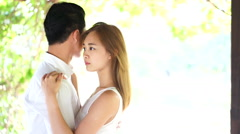 Cool asian couple in high key Stock Footage