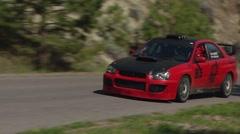 Motorsports, hillclimb race, into hairpin, Red subaru WRX Stock Footage