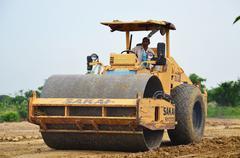Road roller steamroller or vibratory roller on construction site Kuvituskuvat