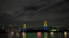 Time Lapse Night View Of Rainbow Bridge And Tokyo Tower From Odaiba Stock Footage