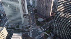 Time Lapse day to night view of Shinjuku office district from above Stock Footage