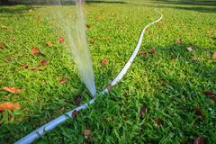 Stock Photo of water flowing leaking  from rubber line tube use for save planet resource ide