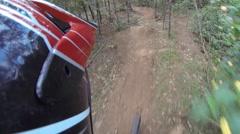 Mountain biking on a single trail Stock Footage