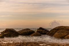 Atmosphere at sunrise on the beach Stock Photos