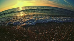 Slow motion. Sea waves near the shore on sunset or sunrise. Stock Footage