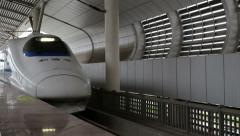 Chinese CRH bullet train arriving at a station Stock Footage