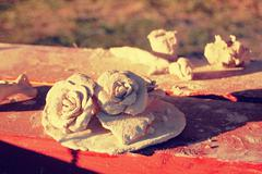 two roses  crude clay - stock photo