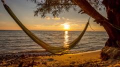 Hammock sunset at the beach Stock Footage