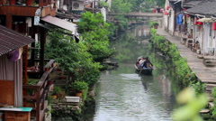 Black-awning boat on canal in Shaoxing Stock Footage