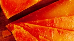 Orange aged delicious cheddar cheese Stock Footage