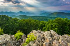 Crepuscular rays over the Blue Ridge Mountains seen from Loft Mountain in She - stock photo