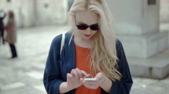 Blonde girl typing on the phone Stock Footage