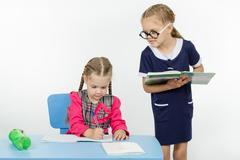 Girl student teacher dictating dictation Stock Photos
