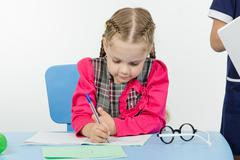 First-grader a lesson at school - stock photo