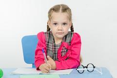 First grader do homework - stock photo