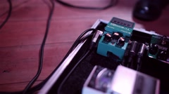 Using guitar pedal - stock footage
