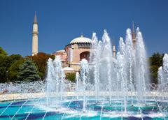 The fontain  in Sultan Ahmet Park with Hagia Sophia in the background Stock Photos