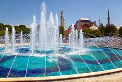 The fontain  in Sultan Ahmet Park with Hagia Sophia in the background. Stock Photos