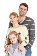 Portrait of happy young family dad mom and daughter, close-up - stock photo