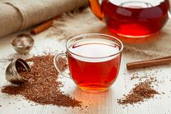 Rooibus tea traditional south africa antioxidant beverage with spices - stock photo