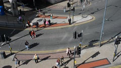 People using pedestrian crossing leeds city centre united kingdom Stock Footage