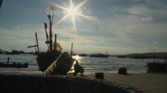 Boat repair on rising sun Stock Footage