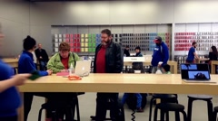 Motion of people browsing new iphone inside Apple store - stock footage