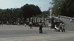 Lourdes 1976: pilgrim walking near the Cathedral - stock footage