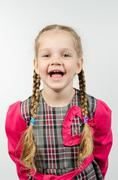 Half-length portrait of a smiling girl four years Stock Photos