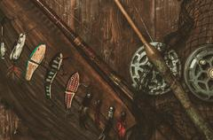 Fishing tools on a wooden background - stock photo