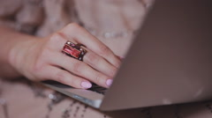 girl's hand with a ring near a laptop keyboard - stock footage