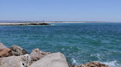 View of jetty lighthouse in Tavira Island inlet, Algarve. Stock Footage
