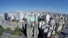 Flying over Sé Cathedral in Sao Paulo, Brazil - stock footage