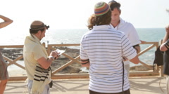 Jewish Men Pray together near the  Sea - stock footage