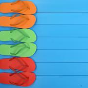 Flip Flops sandals in summer on beach, vacation with copyspace - stock photo