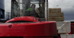 Forklift handling shipment at a busy industrial port. - stock footage