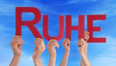People Hold Straight Ruhe Means Rest Blue Sky - stock photo