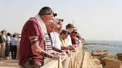 Jewish Men Pray together near the  Sea Stock Footage