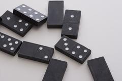 Fallen dominos Stock Photos