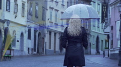 Focus Shifting From Walking Woman To Drops Stock Footage