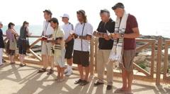 Jewish Men Pray together near the  Sea - stock footage
