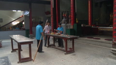 Prepare Incense in a temple Stock Footage