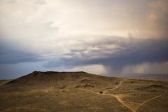 Dark Storm Clouds Gather and Rain Down Stock Photos