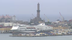 ITALY Genova harbor with cruise ship and lighthouse Stock Footage