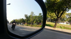 Street view from car side mirror. Let all the cars pass by Stock Footage
