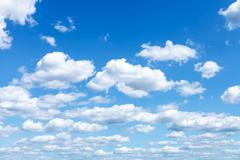 Many white clouds in summer blue sky Stock Photos