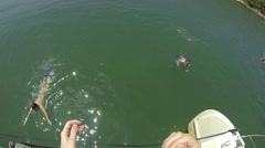 First person POV jumping off the boat to the sea Stock Footage