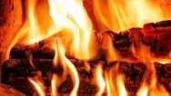 Stock Video Footage of Logs burning in fireplace